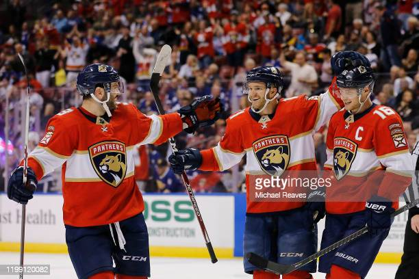 Jonathan Huberdeau of the Florida Panthers celebrates with teammates after assisting a goal which made him the the alltime Florida Panthers leader in...