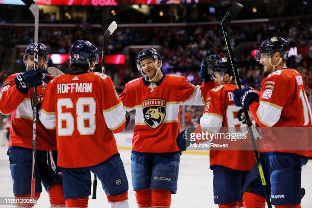 Jonathan Huberdeau of the Florida Panthers celebrates with teammates after assisting a goal which made him the the all-time Florida Panthers leader...