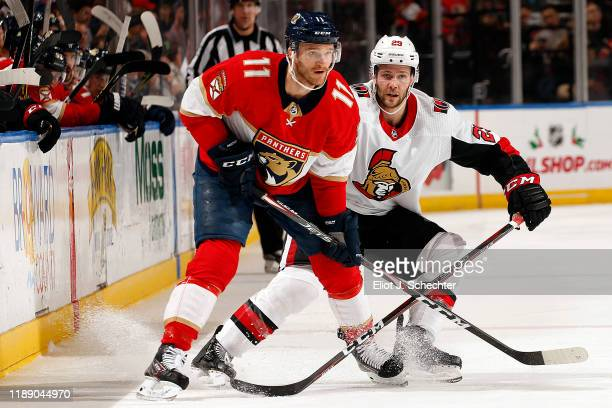 Jonathan Huberdeau of the Florida Panthers crosses sticks with Cody Goloubef of the Ottawa Senators at the BBT Center on December 16 2019 in Sunrise...