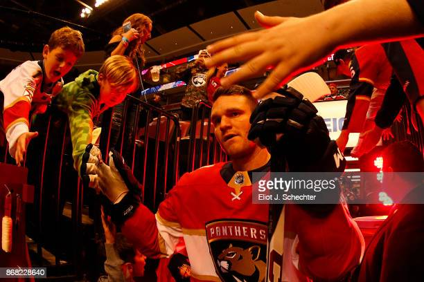 Jonathan Huberdeau of the Florida Panthers heads out to the ice for warm ups prior to the start of the game against the Detroit Red Wings at the BBT...
