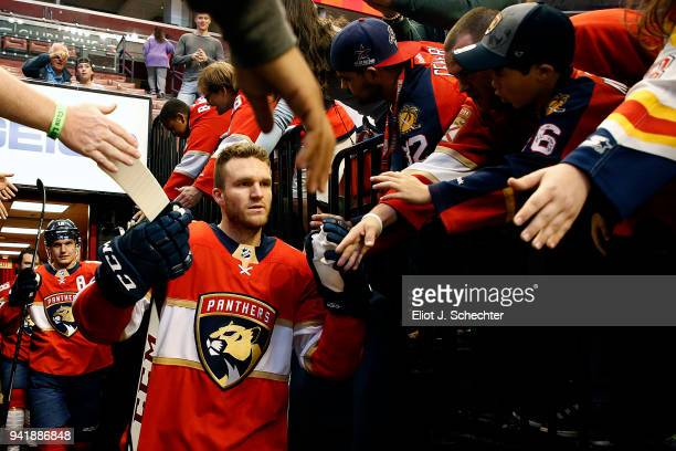 Jonathan Huberdeau of the Florida Panthers heads out to the ice for warm ups prior to the start of the game against the Carolina Hurricanes at the...