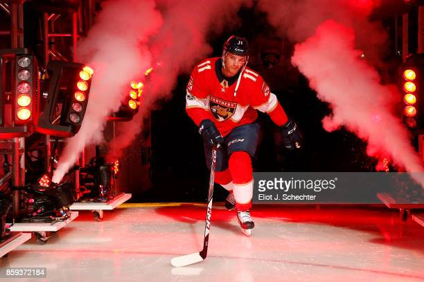 Jonathan Huberdeau of the Florida Panthers heads out to the ice during opening festivities prior to the start of the game against the Tampa Bay...