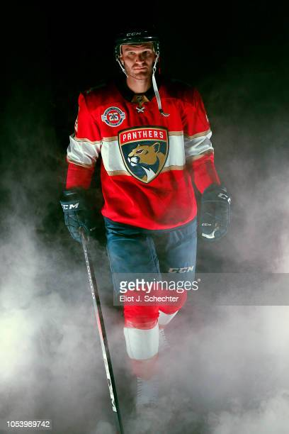 Jonathan Huberdeau of the Florida Panthers heads to the ice during introductions prior to their season home opener against the Columbus Blue Jackets...