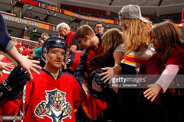 Jonathan Huberdeau of the Florida Panthers is greeted by fans prior to the start of the game against the Ottawa Senators at the BBT Center on...