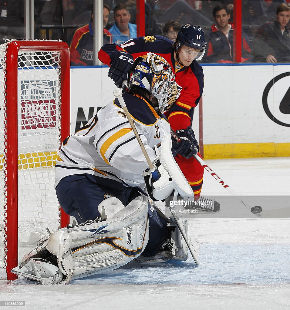 Jonathan Huberdeau #11 of the Florida Panthers is unable to gain control of the puck as goaltender Ryan Miller #30 of the Buffalo Sabres defends the net at the BB&T Center on February 28, 2013 in Sunrise, Florida. The Sabres defeated the Panthers 4-3 in a shootout.
