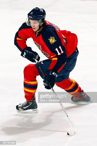 Jonathan Huberdeau of the Florida Panthers moves the puck against the Boston Bruins at the BBT Center on February 24 2013 in Sunrise Florida