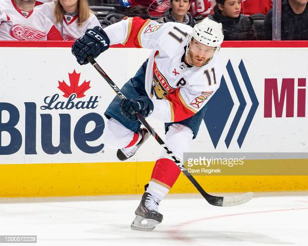 Jonathan Huberdeau of the Florida Panthers passes the puck against the Detroit Red Wings during an NHL game at Little Caesars Arena on January 18...