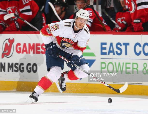 Jonathan Huberdeau of the Florida Panthers plays the puck during the game against the New Jersey Devils at Prudential Center on November 11 2017 in...