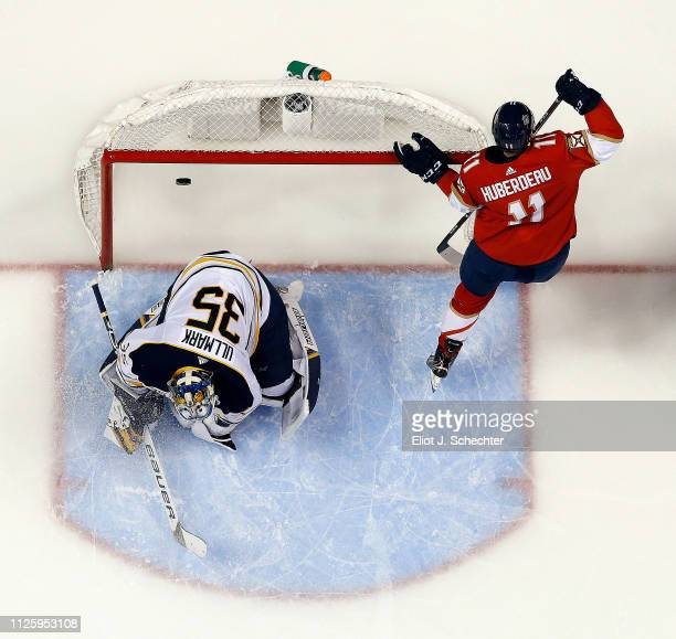 Jonathan Huberdeau of the Florida Panthers scores a goal against Goaltender Linus Ullmark of the Buffalo Sabres at the BBT Center on February 19 2019...