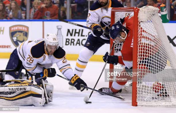 Jonathan Huberdeau of the Florida Panthers scores a goal during a game against the Buffalo Sabres at BBT Center on April 8 2017 in Sunrise Florida