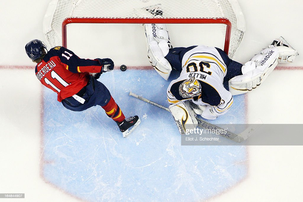 Jonathan Huberdeau #11 of the Florida Panthers scores a goal in a shootout against Goaltender Ryan Miller #30 of the Buffalo Sabres at the BB&T Center on March 28, 2013 in Sunrise, Florida.
