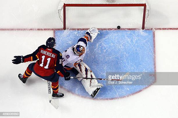 Jonathan Huberdeau of the Florida Panthers scores a goal in the shoot out against Goaltender Jaroslav Halak of the New York Islanders at the BBT...