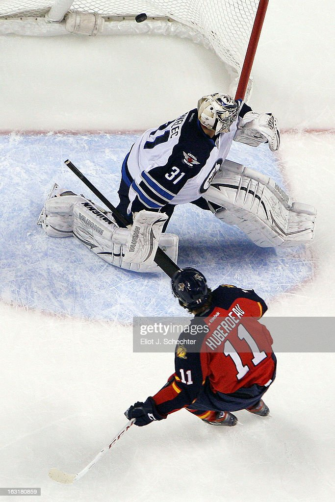 Jonathan Huberdeau #11 of the Florida Panthers scores a goal on a penalty shot against Goaltender Ondrej Pavelec #31 of the Winnipeg Jets at the BB&T Center on March 5, 2013 in Sunrise, Florida.