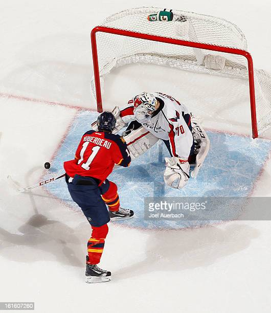 Jonathan Huberdeau of the Florida Panthers scores a second period goal against Goaltender Braden Holtby of the Washington Capitals at the BBT Center...