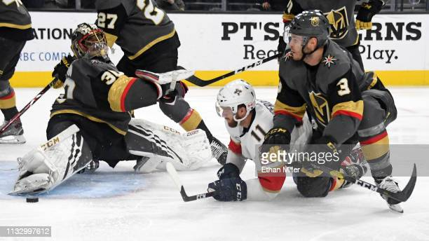 Jonathan Huberdeau of the Florida Panthers scores a thirdperiod goal against Malcolm Subban and Brayden McNabb of the Vegas Golden Knights during...