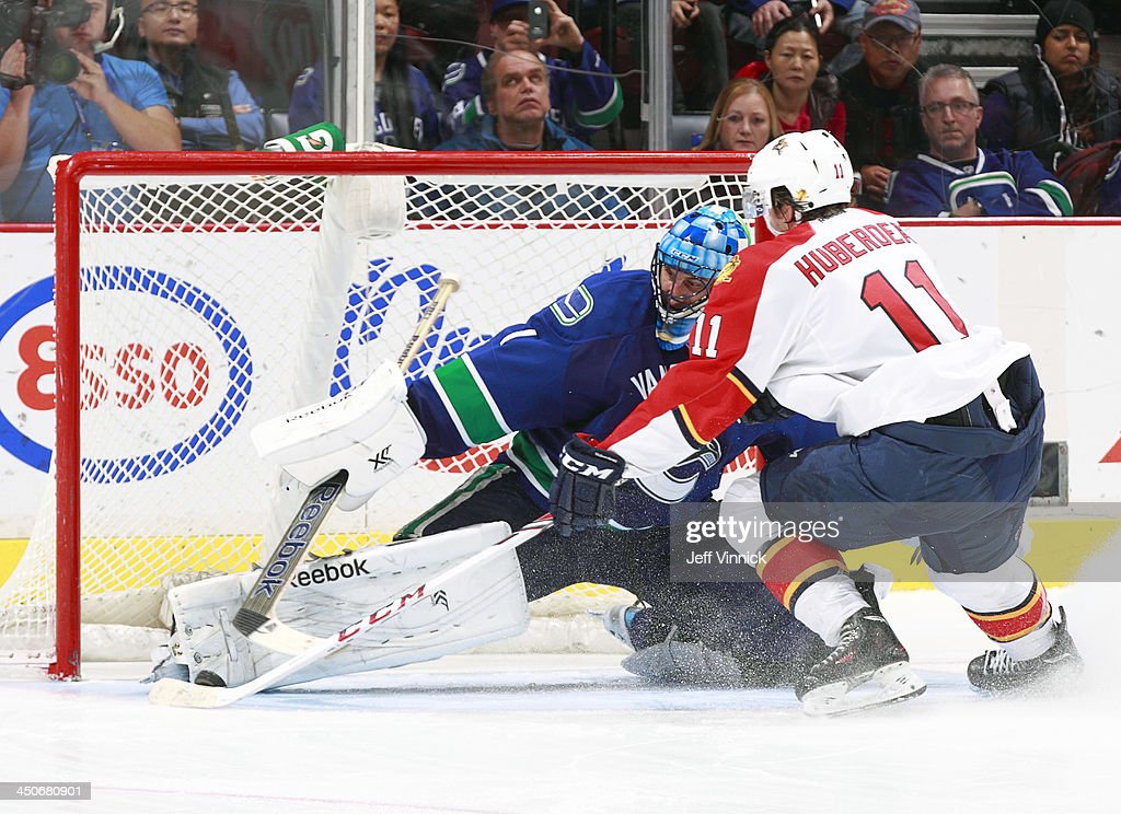 Jonathan Huberdeau #11 of the Florida Panthers scores on Roberto Luongo #1 of the Vancouver Canucks in the shootout during their NHL game at Rogers Arena on November 19, 2013 in Vancouver, British Columbia, Canada. Florida won 3-2 in a shootout.