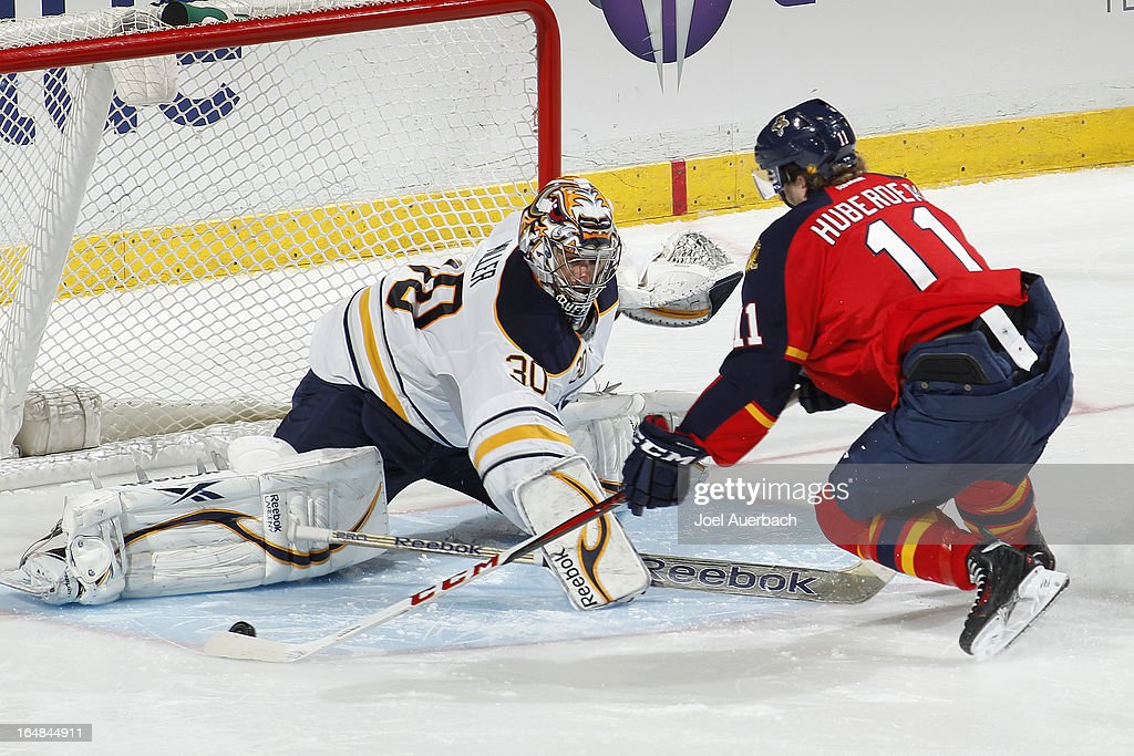 Jonathan Huberdeau #11 of the Florida Panthers scores past goaltender Ryan Miller #30 of the Buffalo Sabres during the shoot out at the BB&T Center on March 28, 2013 in Sunrise, Florida. The Panthers defeated the Sabres 5-4 in a shoot out.