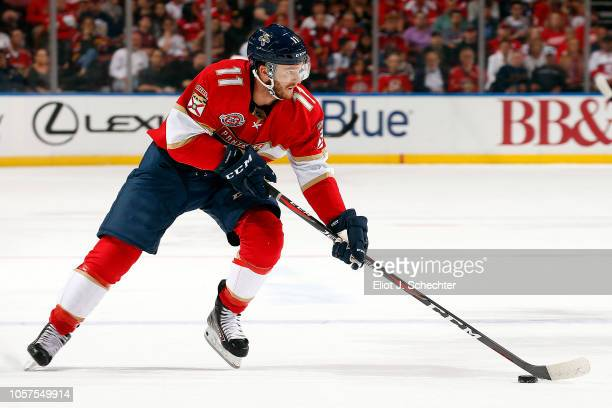 Jonathan Huberdeau of the Florida Panthers skates with the puck against the Detroit Red Wings at the BBT Center on October 20 2018 in Sunrise Florida