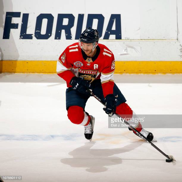 Jonathan Huberdeau of the Florida Panthers skates with the puck against the Buffalo Sabres at the BBT Center on November 30 2018 in Sunrise Florida