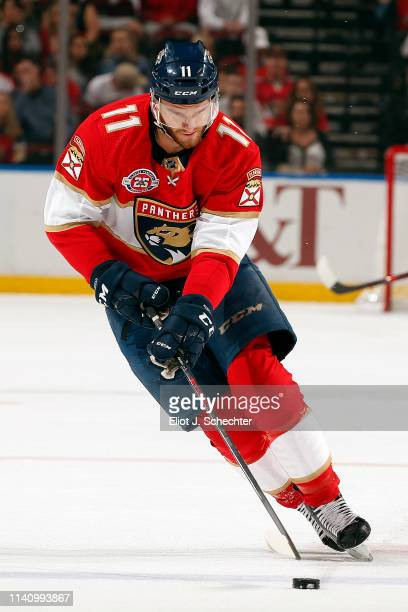 Jonathan Huberdeau of the Florida Panthers skates with the puck against the New Jersey Devils at the BBT Center on April 6 2019 in Sunrise Florida