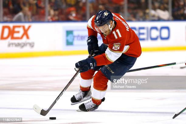 Jonathan Huberdeau of the Florida Panthers skates with the puck against the Carolina Hurricanes during the third period at BBT Center on October 08...