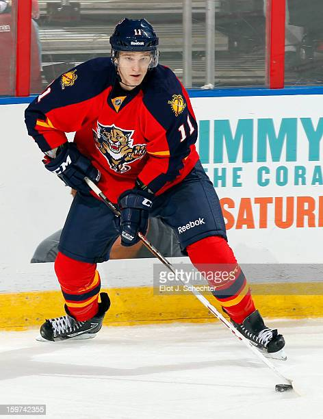 Jonathan Huberdeau of the Florida Panthers skates with the puck against the Carolina Hurricanes at the BBT Center on January 19 2013 in Sunrise...