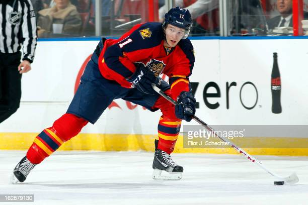 Jonathan Huberdeau of the Florida Panthers skates with the puck against the Buffalo Sabres at the BBT Center on February 28 2013 in Sunrise Florida