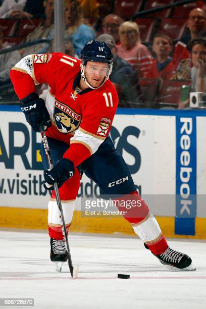 Jonathan Huberdeau of the Florida Panthers skates with the puck against the Buffalo Sabres at the BBT Center on April 8 2017 in Sunrise Florida