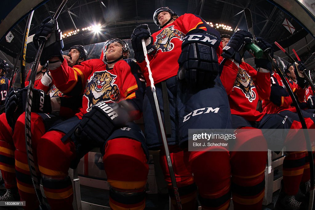 Jonathan Huberdeau #11 of the Florida Panthers stands up before jumping back in for a shift against the Winnipeg Jets at the BB&T Center on March 8, 2013 in Sunrise, Florida.