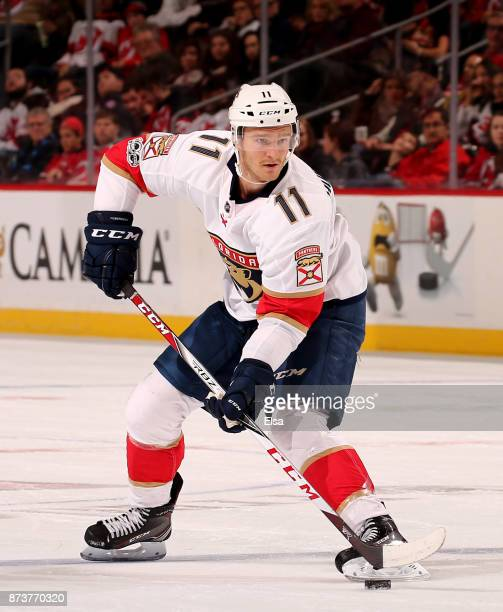 Jonathan Huberdeau of the Florida Panthers takes the puck in the first period against the New Jersey Devils on November 11 2017 at Prudential Center...