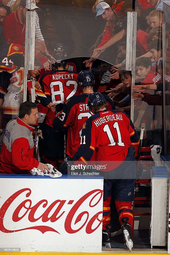 Jonathan Huberdeau #11 of the Florida Panthers walks off the ice with teammates after a 4-0 loss against the Toronto Maple Leafs at the BB&T Center on April 25, 2013 in Sunrise, Florida.