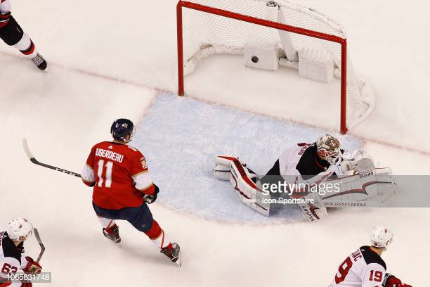 Jonathan Huberdeau watches as the puck shot by Mike Hoffman of the Florida Panthers scores the winning goal in overtime past Goaltender Keith Kinkaid...