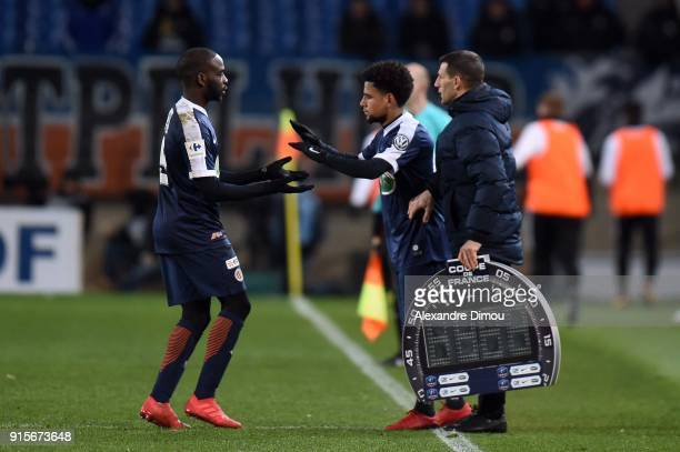 Jonathan Ikone and Keagan Dolly of Montpellier during the French Cup match between Montpellier and Lyon at Stade de la Mosson on February 7 2018 in...