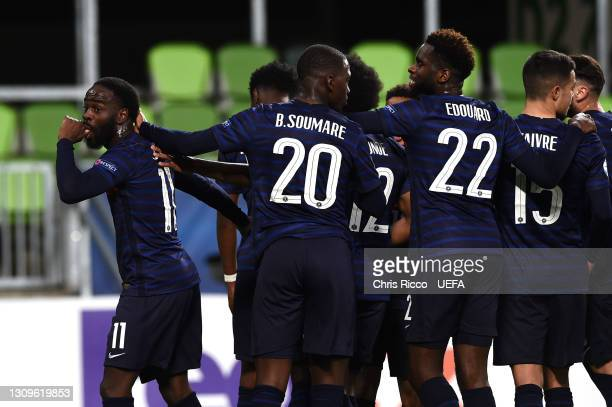 Jonathan Ikone of France celebrates with Odsonne Edouard and team mates after scoring their side's second goal from the penalty spot during the 2021...