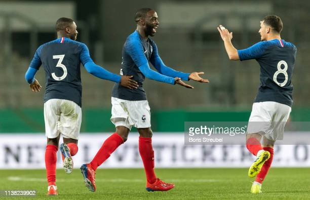 Jonathan Ikone of France celebrates with team mates after scoring his team's first goal during the International Friendly match between Germany U21...