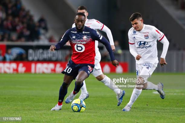 Jonathan Ikone of Lille OSC controls the ball against Bruno Guimaraes of Olympique Lyonnais during the Ligue 1 match between Lille OSC and Olympique...