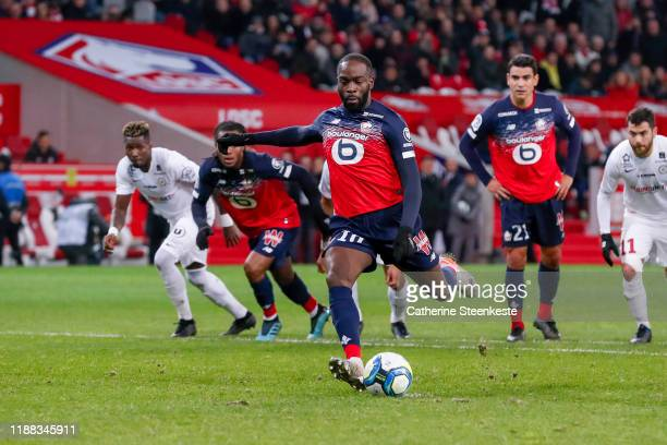 Jonathan Ikone of Losc shoots and scores a penalty during the Ligue 1 match between Lille OSC and Montpellier HSC at Stade Pierre Mauroy on December...