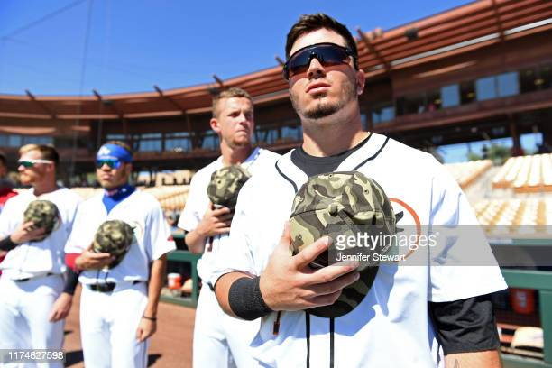 Jonathan India of the Glendale Desert Dogs looks on during the national anthem before the game against the Scottsdale Scorpions at Camelback Ranch on...