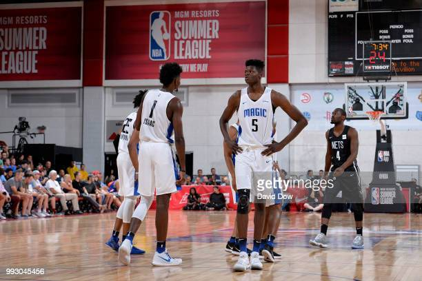 Jonathan Isaac and Mohamed Bamba of the Orlando Magic look on during the game against the Brooklyn Nets during the 2018 Las Vegas Summer League on...