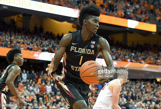 Jonathan Isaac of the Florida State Seminoles controls a rebound against the Syracuse Orange during the second half at the Carrier Dome on January 28...