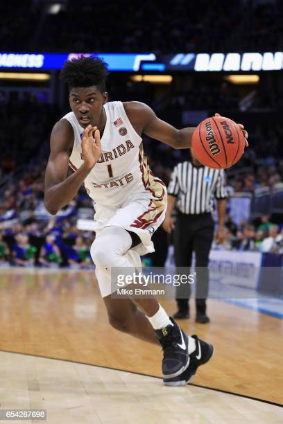 Jonathan Isaac of the Florida State Seminoles dribbles the ball in the first half against the Florida Gulf Coast Eagles during the first round of the...