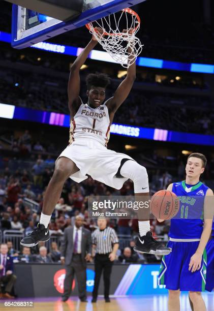 Jonathan Isaac of the Florida State Seminoles dunks the ball in the second half against the Florida Gulf Coast Eagles during the first round of the...