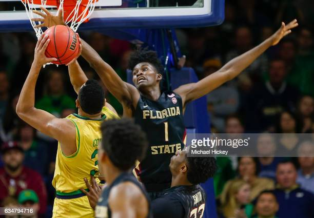 Jonathan Isaac of the Florida State Seminoles reaches for the shot put up by Bonzie Colson of the Notre Dame Fighting Irish at Purcell Pavilion on...