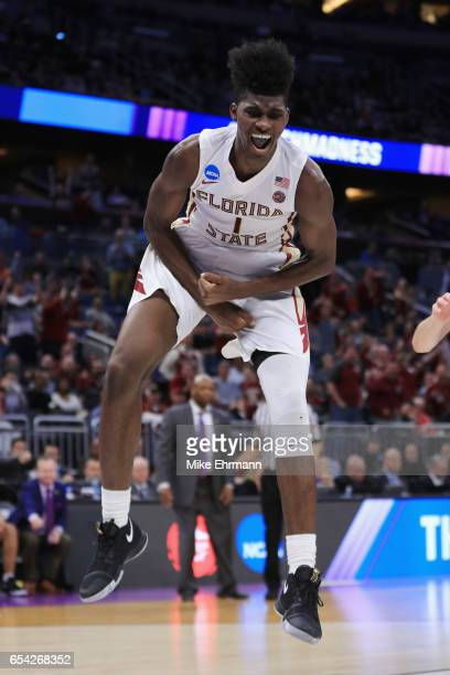 Jonathan Isaac of the Florida State Seminoles reacts after dunking the ball in the second half against the Florida Gulf Coast Eagles during the first...