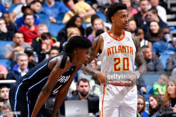 Jonathan Isaac of the Orlando Magic and John Collins of the Atlanta Hawks look on during the game on March 17 2019 at Amway Center in Orlando Florida...