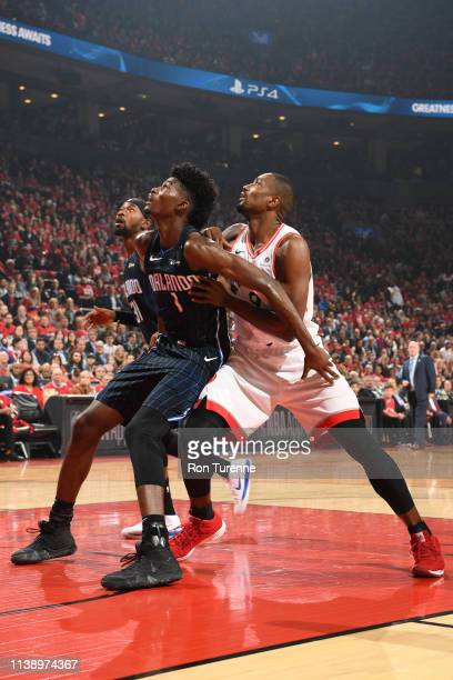 Jonathan Isaac of the Orlando Magic and Serge Ibaka of the Toronto Raptors fights for position to grab the rebound during Game Five of Round One of...