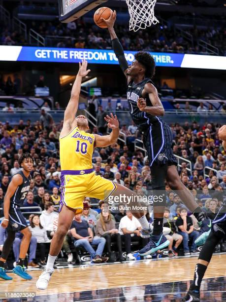 Jonathan Isaac of the Orlando Magic blocks the shot of Jared Dudley of the Los Angeles Lakers during the game at the Amway Center on December 11 2019...