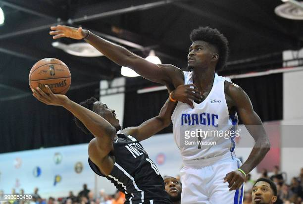 Jonathan Isaac of the Orlando Magic contests a shot from Semaj Christon of the Brooklyn Nets during the 2018 NBA Summer League at the Cox Pavilion on...