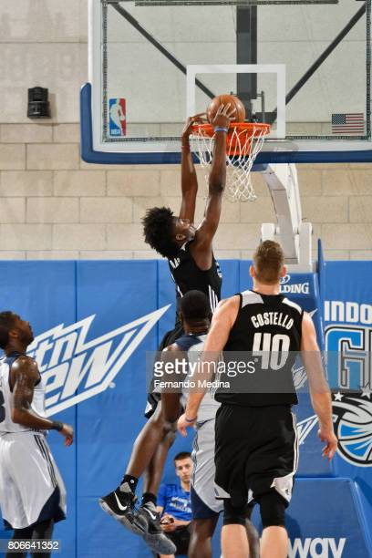 Jonathan Isaac of the Orlando Magic dunks against the Dallas Mavericks on July 3 2017 during the 2017 Summer League at Amway Center in Orlando...