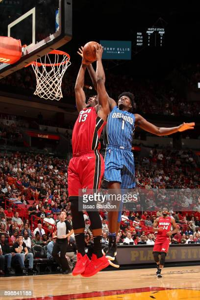 Jonathan Isaac of the Orlando Magic goes for ball as Bam Adebayo of the Miami Heat shoots the ball on December 26 2017 at American Airlines Arena in...